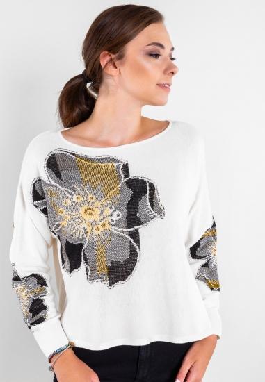 Sweter z kwiecistym motywem...